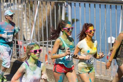 color run, rainbow run, running, runners, jogging, race, paint, young, girls, sunglasses, fitness, exercise, shorts, long hair, brunettes, people, team, group, athletes