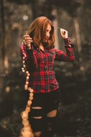 people, woman, girl, ripped jeans, outdoor, string, lights, bokeh