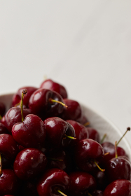 cherries,   bowl,   fruit,   close up,   food,   fresh,   diet,   breakfast,   healthy,   natural,   ingredient,   organic,   group,   juicy,   eating,   red,   berry,  copyspace