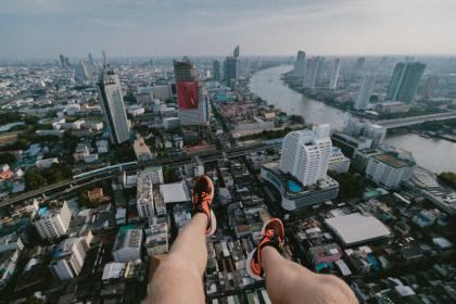 city, urban, buildings, rooftop, edge, people, man, guy, legs, travel, millenials