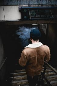 beanie, back, guy, man, people, stairs, floor, checkered, leather, jacket, brown, steel, dark