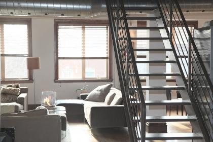 condo, loft, apartment, house, stairs, steps, hardood, floors, couches, lamps, windows, blinds, vents, pipes, railing, furniture