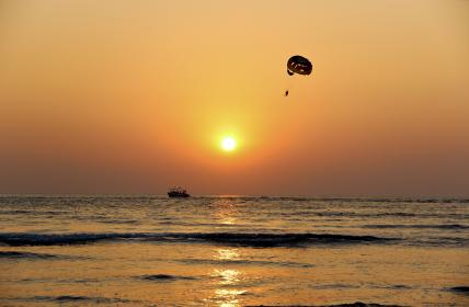 nature, water, ocean, sea, reflection, boat, paragliding, parachute, sunset, sunrise, sky, horizon, clouds, gradient, yellow, gray