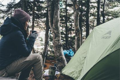 camping, tent, nature, girl, woman, people, jacket, hood, pants, hat, toque, beanie, trees, gear, outdoors