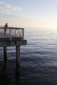 pier,  man,  ocean,  sea,  seascape,  sunlight,  sky,  waves,  solo,  male,  standing,  dock,  water,  lonely,  outdoors,  peaceful