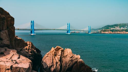 sea, ocean, blue, water, waves, nature, landscape, mountain, rocks, hill, cliff, rocks, architecture, bridge, infrastructure, view, sky