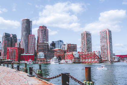 city,  buildings,  harbor,  boats,  pier,  shore,  ocean,  sea,  cityscape,  waterfront,  business,  hotel,  sky,  clouds,  architecture