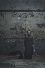 people, woman, black, clothing, torch, dark, fire, outside, wall