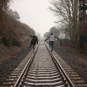 people, train tracks, railroad, railway, girl, guy, friends