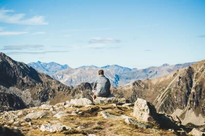 mountain, valley, hill, cliff, rocks, landscape, blue, sky, clouds, people, man, sitting, alone, mountaineer, hiker, hiking, climbing, sunny, day, daylight, travel, outdoors, summer, adventure