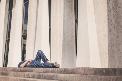 steps, man, guy, lying down, jeans, pants, shoes, building, pillars