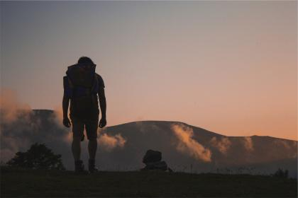 hiking, hiker, backpack, outdoors, mountains, sunset, sky, shorts, tshirt, guy, man, people, fitness