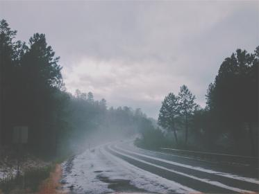 road, highway, snow, winter, guard rail, trees, forest, woods, car, fog, grey, sky, clouds, cloudy