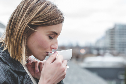 woman,  sipping,  tea,  outside,  person,  people,  cold,  blonde,  pretty,  female,  girl