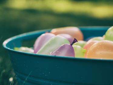 still, items, things, water, balloons, stack, pile, tub, basin, droplets, wet, colors, bokeh
