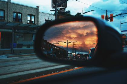 car, mirror, road, trip, travel, traffic, light, building, downtown, sky, clouds, transmission, line, sunset
