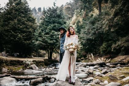 people, girl, guy, wedding, gown, bouquet, flower, river,  water, rocks, outdoor, nature, trees, plants