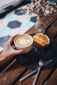 latte,  cake,  flowers,  coffee,  hand,  holding,  breakfast,  dessert,  restaurant,  silverware,  caffeine,  milk,  hot drink,  beverage,  food,  close up