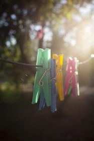 pin, clothespin, clip, clothes, colorful, green, blue, blur, wire, morning, sunlight, summer
