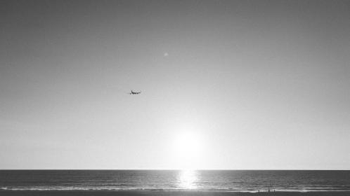 airplane, travel, trip, sunset, beach, water, ocean, black and white, sand