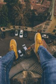 people, shoe, jeans, rooftop, car, parking, lot, buildings, tree
