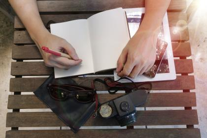 hand, arm, notebook, pen, write, tablet, mobile, phone, gadget, sunglasses, camera, wooden, table