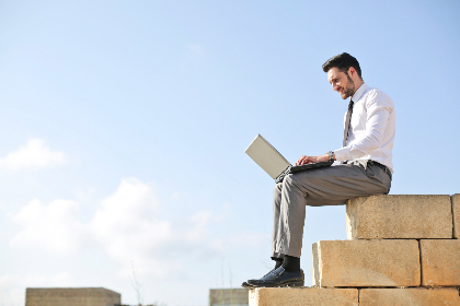 man,  laptop,  wall,  alone,  isolated,  beard,  business,  work,  smile,  happy,  blue sky