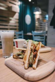 food, sandwich, coffee, wood, table, glass, cup, chairs, restaurant, delicious, meat, vegetables