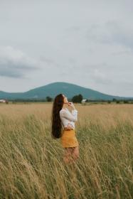 people, girl, woman, alone, green, grass, outdoor, nature, landscape, mountain, view, sky, relax