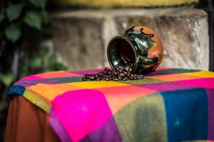 table, setup, cloth, ceramic, cup, mug, coffee bean, colorful, plant, outside