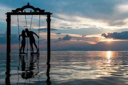 couple, kissing, love, romance, swing, ocean, sea, sunset, dusk, silhouette, clouds, people