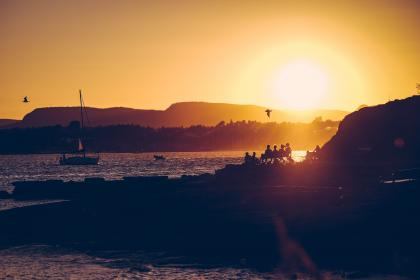 sunset, dusk, sky, beach, sand, shore, coast, sailboat, birds, people, silhouette, shadows, ocean, sea, lake, water, landscape, nature, summer