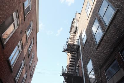 buildings, houses, apartments, windows, fire escape, stairs, steps, ladders, sky, bricks, walls