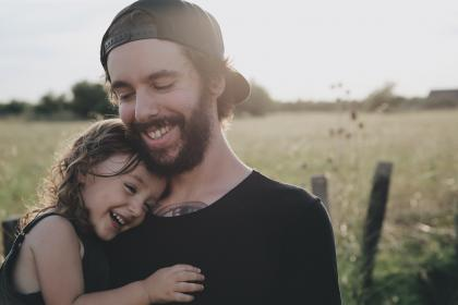 people, father, daughter, smile, happy, hug, carry, love, field, trees, beard, cap, child, girl