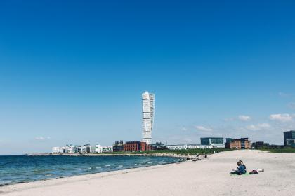 beach, sand, water, shore, ocean, sunny, summer, blue, sky, city, buildings, architecture, people