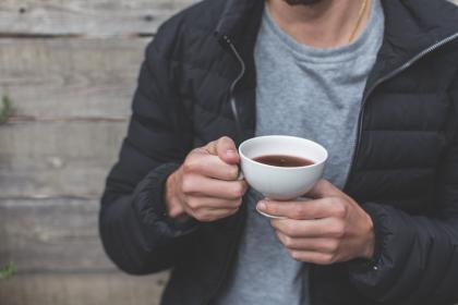 people, male, man, drink, cup, tea, healthy, lifestyle, black, jacket, wooden, wall, outdoor