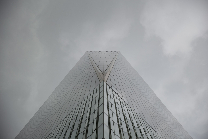 tall,  skyscraper,  clouds,  building,  architecture,  city,  urban,  industrial,  offices,  business,  corporate,  downtown,  windows,  sky,  moody,  gloomy,  grayscale,  daunting