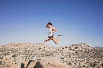 people, man, jump, trees, desert, alone, fashion, beauty, shorts, slippers, brown, rocks, green, plant