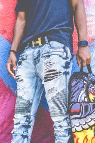 guy, man, fashion, ripped, jeans, colorful, wall, graffiti, art, belt, hermes, watch, bag, african american, clothing