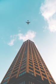 architecture, building, infrastructure, sky, skyscraper, tower, blue, sky, airplane, airline, travel, trip, flight