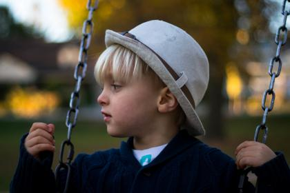 people, kid, boy, child, swing, chain, hat, playground