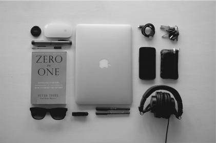 apple, macbook, laptop, computer, technology, mouse, lens, pens, pencil, book, startups, zero to one, business, sunglasses, headphones, audio, cell phone, mobile, cables, keys, black and white