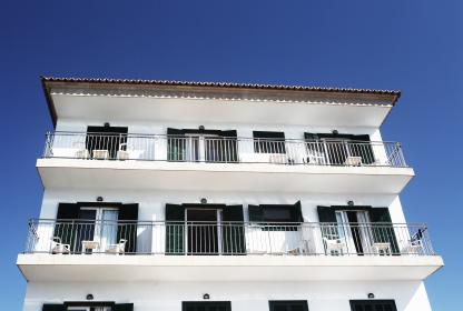 white, house, apartment, balcony, balconies, windows, shutters, railings, tables, chairs, blue, sky