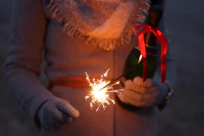 fireworks, holiday, celebration, christmas, dark, night, lights, fire, spark, people, woman, ribbon, gloves, sweater, scarf
