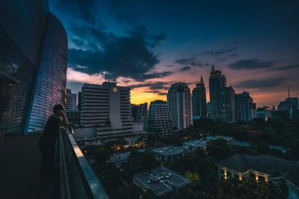 architecture, building, infrastructure, dark, clouds, sky, skyscraper, tower, rooftops, skyline, city, urban, people, talking, man, guy, alone