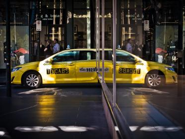 yellow, taxi, car, vehicle, transportation, city, urban, road, street, crowd, people, mirror, reflection
