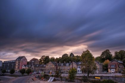 sky, clouds, road, street, trees, plant, building, structure, houses, construction, transmission, line, car, vehicle, parking