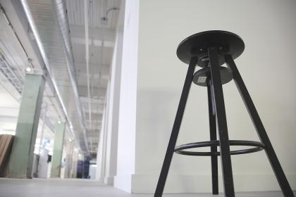 stool, steat, black, warehouse, industrial, pipes, vents, beams, white