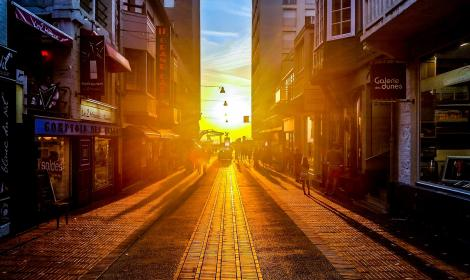 sunset, street, road, buildings, stores, shops, caffes, restaurants, pedestrians, people, walking, cars, sidewalk