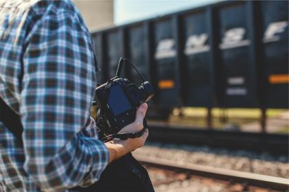 cannon, camera, slr, photographer, photography, technology, train tracks, railroad, railway, man, guy, people